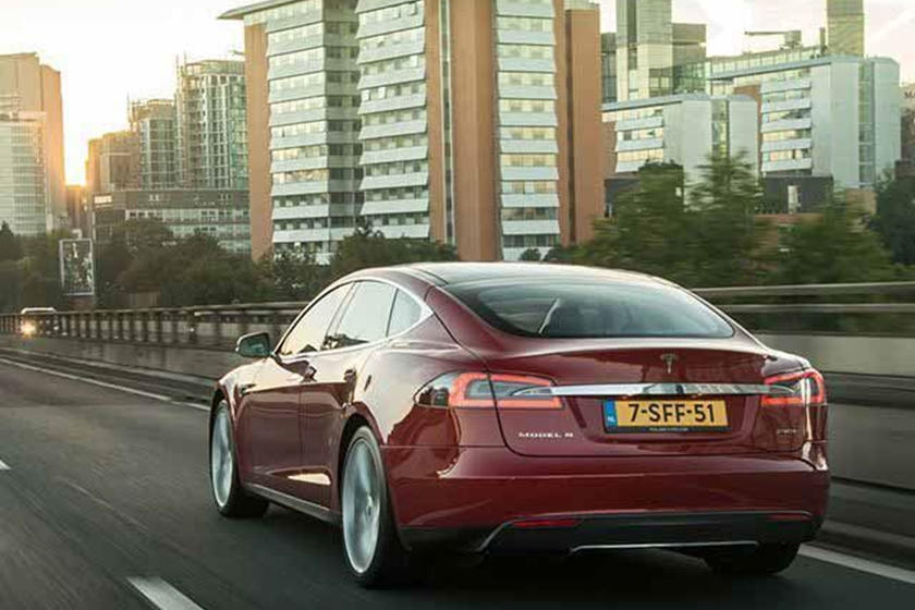 Tesla Working On Battery Swap Tech That Fits On The Back Of