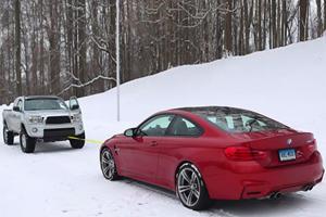 Toyota Tacoma Vs BMW M4 Snow Tow Contest Is Brilliant Winter Fun