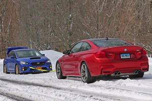 You're About To See A Subaru WRX STI Vs. BMW M4 In A Snow Tow Duel