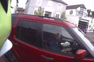 Watch A Cyclist Rip Into A Driver For Eating Breakfast While Behind The Wheel