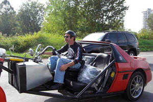 A Pontiac Fiero Mates with a Motorcycle