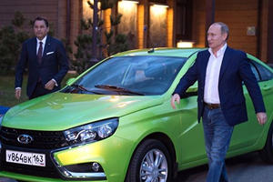 Putin Test Drives Little Green Car To Save The Russian Auto Industry