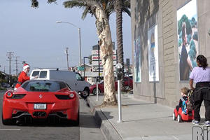 Watching Santa Deliver Presents In A Ferrari 458 Will Get You In The Holiday Spirit