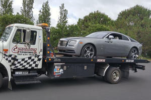 Listen To This Guy's Reaction To The NYPD Towing A Rolls-Royce