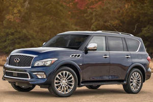 Should You Buy An Infiniti QX80 Instead Of A Bling-tastic Cadillac Escalade?