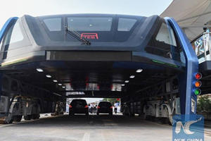 That Giant Bus Cars Can Driver Under Is Here And As Weird As You Imagined