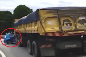 How Did This Massive Truck Not Notice The Hatchback Stuck In Its Grille?