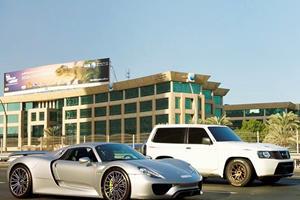 A Porsche 918 Spyder Races A Nissan Patrol SUV And Walks Away A Loser