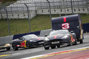 Watch F1 Drivers Crash Some Caravans In Aston Martins For Fun