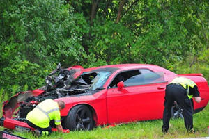 Who Crashes A Dodge Challenger Outside A Car Museum? This Guy