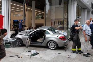 Mercedes SLK Crashes Into Tesla Dealership In San Francisco
