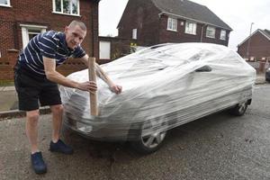 Guy Wraps Stranger's Car In Plastic For Parking Outside His House