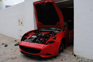 Tunisians Destroy Ferrari Owned by Family of Exiled President