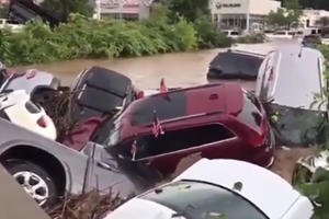 Watch A Flash Flood Send A Dealership's Cars Up A River And Into A Bridge