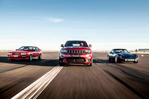 Watch The Jeep Grand Cherokee Trackhawk Drag Race And Smash Two Iconic Sports Cars