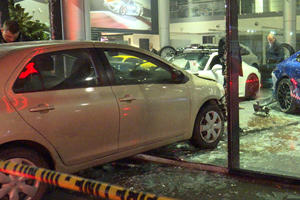 Guy Crashes Into Porsche Dealership After Getting Dumped