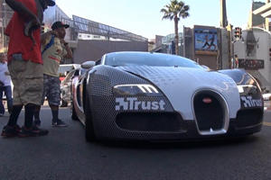 Snakes in a Bugatti Veyron Grand Sport at the Finish of Gumball