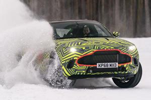 Watch Aston Martin Drift Its DBX Prototype Through The Snow