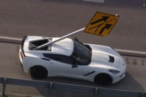 Flying Road Sign Smashes Into Corvette
