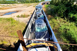 $2M Worth Of Fords Destroyed As Train Crashes Into Low Bridge