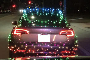 Police Stop Tesla Owner Trying Too Hard To Love Christmas