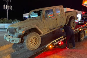 Jeep Gladiator Owner Who Voided Warranty For Mud Driving Forced To Fix Truck Herself