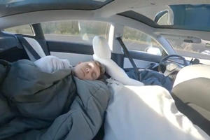 World's Worst Parent Films Son Asleep In Tesla While Driving