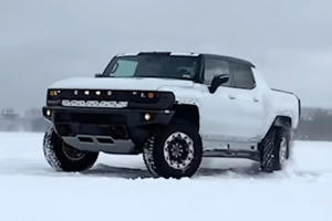 Watch A GMC Hummer EV Do Donuts In The Snow