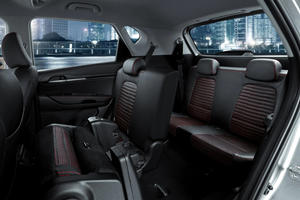 Kia Reveals New Tiny Seven-Seat SUV