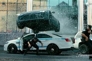 Watch An Aston Martin Vantage Crash Through A Building In Mark Wahlberg's 'Infinite'
