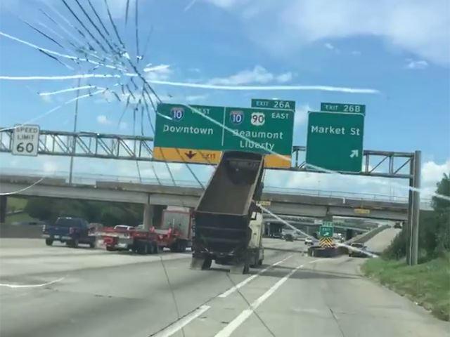 Dump Truck Driver Destroys Freeway Sign In Crazy Crash | CarBuzz